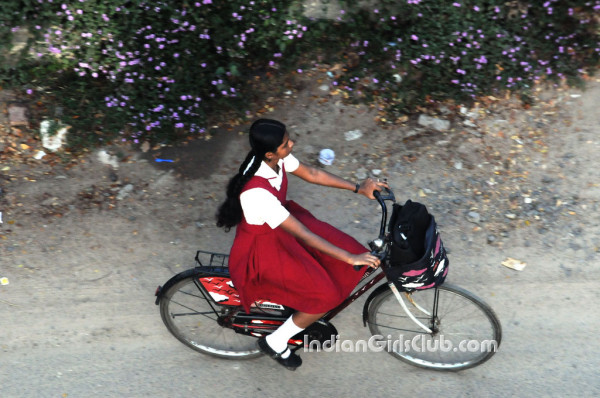 beautiful chennai school girl in uniform riding bicycle to home
