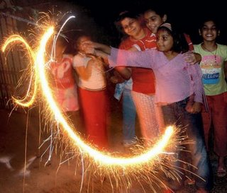 childrens celebrating diwali bursting crackers and fireworks