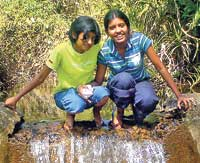 "Kavindi Jayawardene, at left, with a friend. ""She was a very loving child, a hard-working student, and a devout Buddhist."""