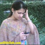 sweet bangladeshi girl using mobile phone