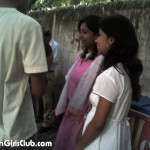 2 young indian girls at bus stop