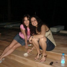 girls enjoying smoke at night