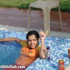 indian girl smoking near swimming pool