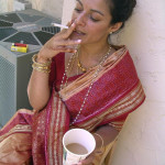 north indian aunty in saree smoking and having tea