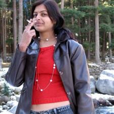 teen south indain girl in jeans pant smoking