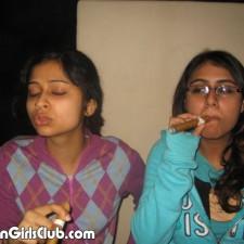 two indian girls in ladies hostel smoking cigar