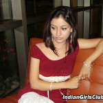 indian girl sitting on sofa