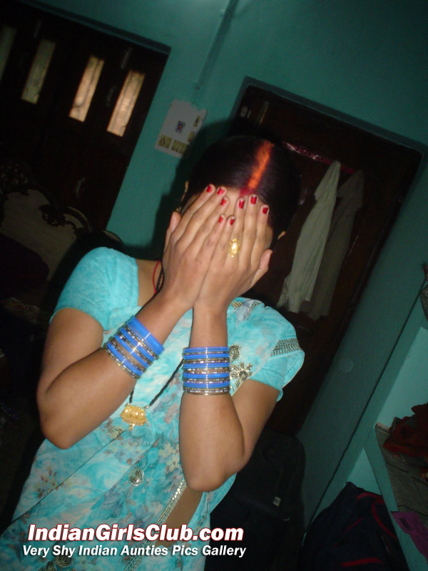shy indian aunty camera posing