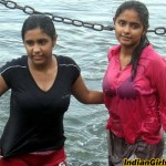 young indian girls bathing river