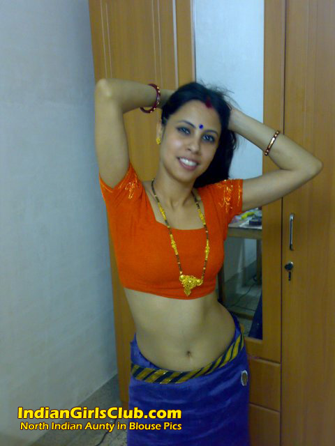 Something orange saree aunty nude