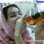 Arab Girl Drinking Bottle of Black Label