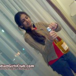 Beautiful Indian Girl Cute in Jeans Pant Opens Bottle
